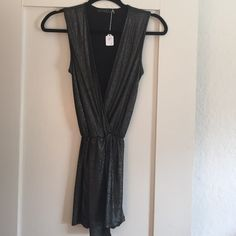 Potter's Pot Metallic Romper Brand new Potter's Pot black metallic romper. Super cute for a night out with your girlfriends! Material: polyester and spandex Potter's Pot Dresses