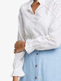 This pretty blouse is perfect for the warmer months in a soft broderie Anglaise fabric. Gently fitted with frill detail along the neck, the sleeve cuffs are pulled in to a create ruffles for a charming bohemian look. Balance the light, feminine design with wide-leg cropped denim and plimsolls.