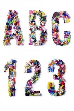 """PhotographerJoshua Scott created some bold custom typography for BULLETT Magazine, a print mag geared towards """"young, international tastemakers"""". Each letter is made up of tiny, colorful objects, ranging baby pink doll hairbrushes to plastic bracelet charms and barrettes, combining to make a bright mosaic of knickknacks and toys."""