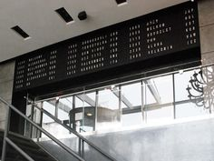 Metal Wall with Display Board — Custom Metal Fabrication in Brooklyn NYC Elevator Lobby, Custom Metal Fabrication, Burger Places, Steel Panels, Long Island City, Metal Walls, Track Lighting, Signage, Ceiling Lights