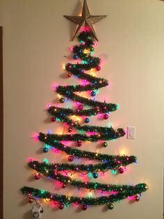 ideas lighting ideas diy wall christmas trees for 2019 Artificial fir tree as Christmas decoration? A synthetic Christmas Tree or perhaps a real one? Wall Christmas Tree, Creative Christmas Trees, Office Christmas Decorations, Diy Christmas Lights, Decorating With Christmas Lights, Rustic Christmas, Simple Christmas, Christmas Crafts, Christmas Ornaments