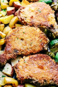 An easy to make dinner using one sheet pan.  Crispy and cheesy coated pork chops cook to tender perfection with roasted potatoes and brussels sprouts.