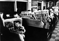 November 23, 1963: People reading newspapers whose front pages reporting Pres. John F. Kennedy's assassination. #JFK #JFK50
