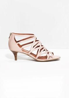 Ladylike strappy sandals with a chic stacked-leather kitten heel.
