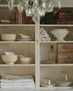 like the mix of old books, ironstone, and linens