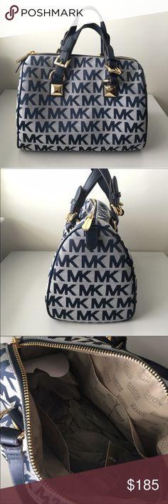 Michael Kors Grayson Handbag Beautiful Grayson handbag by Michael Kors. Navy blue color with golden hardware for a sophisticated look. Signature MK monogram on the exterior. Very gorgeous and spacious handbag! Michael Kors Bags