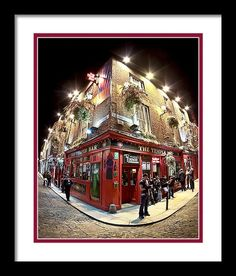 Irish Pub Framed Print featuring Bright Lights Of Temple Bar In Dublin Ireland by Mark E Tisdale