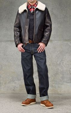 Shop this look on Lookastic:  http://lookastic.com/men/looks/long-sleeve-shirt-waistcoat-boots-jeans-belt-shearling-jacket/7163  — Red Plaid Long Sleeve Shirt  — Black Cotton Waistcoat  — Brown Leather Boots  — Charcoal Jeans  — Brown Leather Belt  — Dark Brown Shearling Jacket