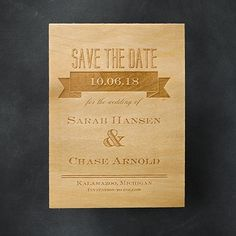 A banner draws attention to the very important information displayed on this etched-wood save the date.