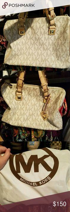 Grayson bag Michael Kors white and tan Grayson handbag.  I am open to trades.  I am open to reasonable offers. Michael Kors Bags