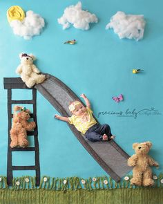 Hilarious photo of 1 month old newborn going down slide with bears. Precious Baby Photography Baby ImaginArt by Angela Forker New Haven Fort Wayne Indiana fun funny adorable unique Baby scene