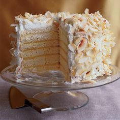 This towering dessert is made up of layers of super-moist, almost puddinglike coconut cake spread with tangy passion fruit curd, then topped with whipped cream and crispy flakes of toasted coconut.