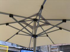 Parasols - available in Black or Taupe. Taupe, Outdoor Furniture, Black, Beige, Black People, Backyard Furniture, Lawn Furniture, Outdoor Furniture Sets