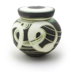 Susan Dewsnap: Cap Lid Jar on The Clay Studio Shop.  Susan's lidded jars range in price from $100.00 to $300.00, Dimensions-Stoneware 5.25'' x 5.25'' x 5'' to 8.25'' x 8.25'' x 5.5''. This item is sold when check on 2/22/15.