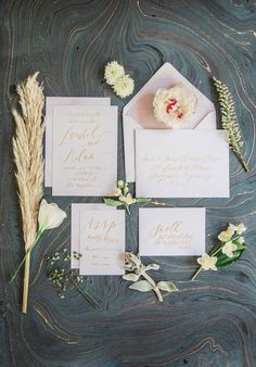 Beautiful in its simplicity, this invitation suite showcases Emily A. Howell's organically modern calligraphy in muted gold. A painterly pop of pink adds visual interest. | Photo by Elizabeth Burgi