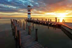 Lighthouse Pier at sunset dusk printed on sailcloth for home décor wall art print 10x144.18 ounce sailcloth Material manufactured and printed in the U.S.A. Waterproof, mildew resistant, and easy to clean Ships within 3 days of order completion Photo quality dye-sublimation printing Ready to frame, mat, stretch, or hang
