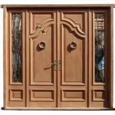 Amazing Solid Door with sidelights. It has wrought iron inserts at the sidelights and comes with glasses installed.  from  Amighini.Com