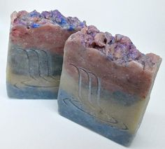 Lady of the Lake Handmade Soap With Coconut Milk    You'll wonder if you've been blessed with a royal calling, surrounded by the scent of Egyptian musk and golden amber blending with notes of sparkling citrus, lily of the valley, warm woods, and pink jasmine.     Ingredients: distilled water, coconut oil, olive oil pomace, avocado oil, shea butter, sodium hydroxide, sweet almond oil, castor oil, fragrance, coconut milk, kaolin clay, titanium dioxide, mica, tin dioxide, ultramarine blue, iron…