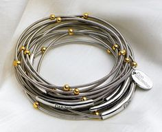 Piano wire bracelet, it is beautiful and inspiring to find a piano to play again!