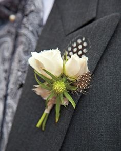 Boutonniere    The groom's boutonniere was fashioned from quail feathers, scabiosa buds, and tuberose, its stems wrapped in blush dupion silk.