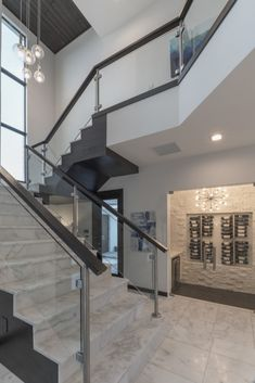 Get inspired by the many custom glass railing pictures from our a glass panel staircase framed with chrome supports and wood railings with marble stairs in this solutioingenieria Images