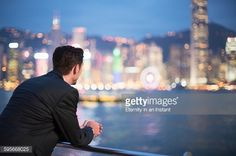 Stock Photo : Young man looking at the view of Hong Kong at nigh