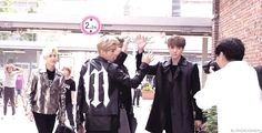 """poor baby Sehunnie """"hurting"""" his hand by having a high five with Luhan and Kai"""