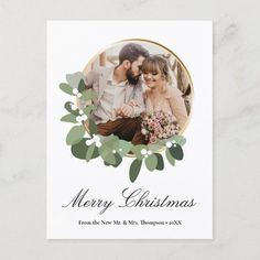 """Personalize this Holiday postcard and share a special wedding photo from your special day. Modern and elegant wreath frame with green leaves and white flowers surround the photo, customizable and easy to use template. Edit the text """"From the New Mr. and Mrs."""" with your last name, change the special message on the back and return address. With them all a Merry Christmas and keep the connection going with your wedding guests, family and friends. Country Wedding Invitations, Beautiful Wedding Invitations, Christmas Holidays, Christmas Cards, Merry Christmas, Holiday Cards, Photo Wreath, First Christmas Married, Frame Wreath"""