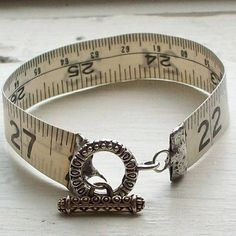 adorable tape measure bracelete by imgfave - What a great idea to give as a gift to a seamstress or a crafter. The supplies to make one of these can probably all be found at Michael's or Hobby Lobby - the tape measure and the jewelry parts.