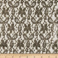 Mystere Lace Gold from @fabricdotcom  Delicate and classic, this sheer lace has a metallic gold foil finish over black lace. This lace has no significant stretch. This fabric appropriate for glitzy lingerie, fancy overlays on skirts or dresses, sparkly feminine apparel accents, and wraps or shrugs.