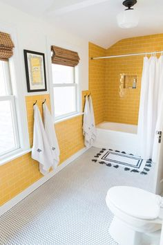 Can't help but brighten MY day! Another Bathroom In This Home That Took Fixtures From Other Bathrooms To Create A More Efficient Space Home Tour On Design*Sponge Modern Bathroom Design, Bathroom Interior Design, Modern House Design, Decor Interior Design, Ideas Baños, Decor Ideas, Tile Ideas, Yellow Tile, Yellow Black