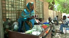 Food: This is a Sudanese woman trying to make a living off selling tea. The Sudanese love all the juices  that they make from their fruits that the harvest a lot in Sudan. those drinks include Tabaidi, Karkadai, Aradaib, Karkadai and Guddaim.