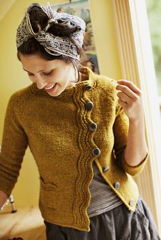 This is a knit sweater, but great inspiration for making a pullover into a cardigan with crochet finishing on the front: purl soho   products   item   levenwick (brooklyn tweed)
