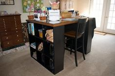You could do this with two small book cases and a desk top.  Look at the marked down section at ikea for the top which could be any solid surface.