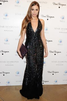 November 10 2012    Amber Le Bon attended the Peace Earth Foundation Ball wearing a Roberto Cavalli sequinned halterneck gown and carried a purple clutch.