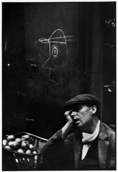 "collective-history:    ""The narrow street of Barcelona's roughest quarter is the home of prostitutes, petty thieves and dope peddlers. But I saw a fruit vendor sleeping against a wall and was struck by the surprisingly gentle and articulate drawing scrawled there.""- Henri Cartier-Bresson, Barcelona ca. 1933"