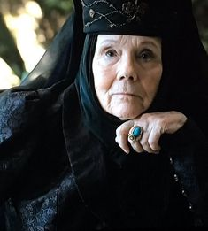 Olenna Tyrell  Finally costume changes ..... even for mourn