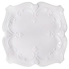 "White dinner plate with scrolling motifs.   Product: Dinner plateConstruction Material: CeramicColor: WhiteFeatures: Scrolling motifDimensions: 10.5"" W x 10.5"" D"