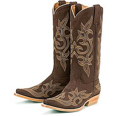 Expert leather craftsmanship styles these cowboy boots from Lane Boots. The dark brown suede upper is highlighted with intricately stitched western-inspired designs. Color options: Brown Height: Knee-