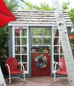 garden greenhouse and potting shed out of old recycled glass windows ~ beautiful and whimsical... love love love!