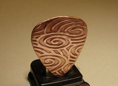Copper guitar pick for swirling waves of sound by NiciLaskin