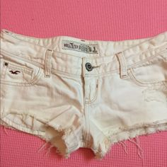 White hollister shorts Very short hollister shorts, size 3 but fits like a size 1. There are two stains showed one is tanning lotion that can be bleached out and the other looks like dirt that could be bleached out as well. Hollister Shorts Jean Shorts