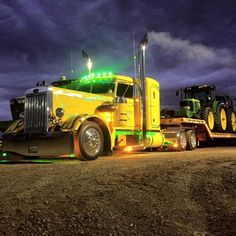 rollerman1:  Custom Needle nose Peterbilt with a load of Deere.
