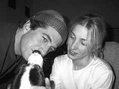 John Jr. and Carolyn Bessette Kennedy with Friday..i i know i have this one on first board..cathleen...but i wanted to place something sweet of the two of them together to begin on my new board! sorry for the repeat!
