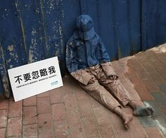 """Don't ingnore me by Liu Bolin Also known as """"The Invisible Man"""", Liu Bolin's most popular works are from his """"Hiding in the City"""" series; photographic works that began as performance art in 2005."""