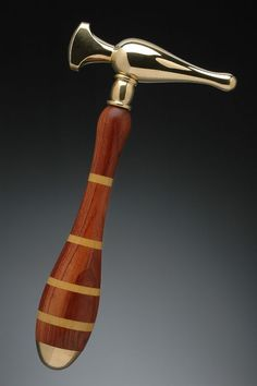 """Three Dimensional Art, Sue Aygarn-Kowalski, Metalsmith, Hammer, 2009, """"My work takes the form of functional tools for the hand in metal, wood, and plastic."""" narrative from website, Photo Credit Dean Powell"""