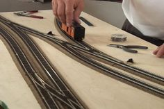 Learn expert tips and techniques for laying model railroad track that will last and look great. #electrictrainsets