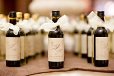 Wine or Champagne Wedding Favors with some Ghirardelli chocolates in a little bag attached with a ribbon....