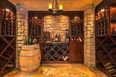 Bedroom transformed to wine cellar - mediterranean - Wine Cellar - Dallas - Barbara Gilbert Interiors