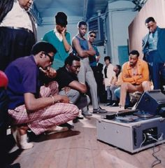 In this photo, The Temptations are reviewing their latest track, circa 1966. The group, from left to right: David Ruffin, Eddie Kendricks, Otis Williams, Melvin Franklin, and Paul Williams